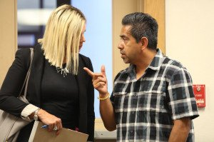 The Rev. Hector Coria talks with his attorney, Jessica Graves, at Tuesday's hearing in Yolo Superior Court